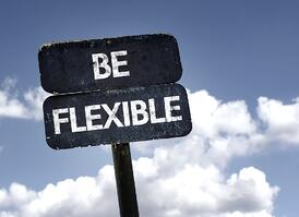 Be Flexible sign with clouds and sky background